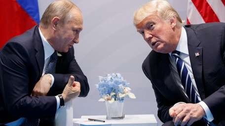 Russian President Vladimir Putin meets with President Donald