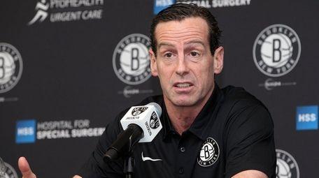 Nets head coach Kenny Atkinson talks to media
