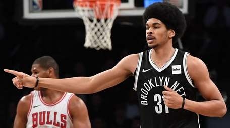 Nets center Jarrett Allen reacts after he scores