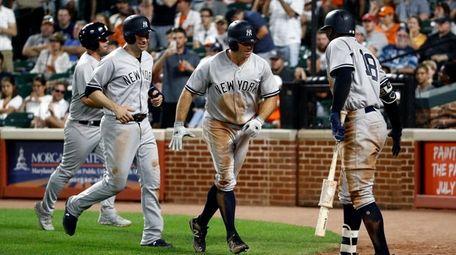 The Yankees' Brett Gardner, second from right, is