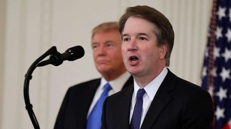 President Donald Trump listens as Judge Brett Kavanaugh,
