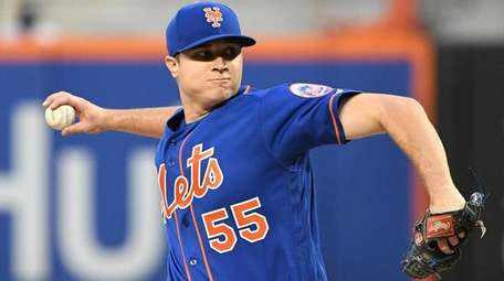 Mets starting pitcher Corey Oswalt delivers against the