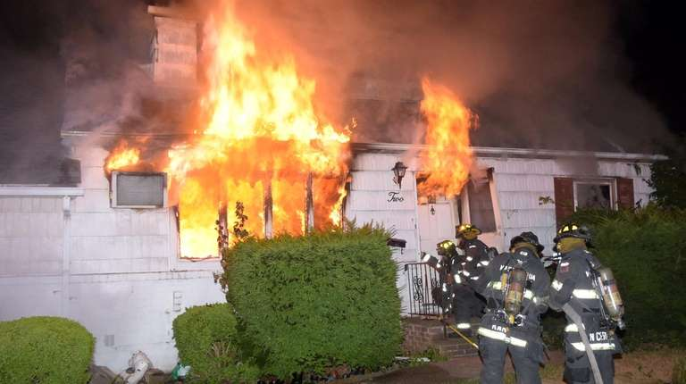 Firefighters at a house fire in North Massapequa