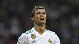 Real Madrid's Cristiano Ronaldo reacts after missing a