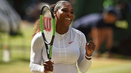 Serena Williams celebrates after beating Camila Giorgi in