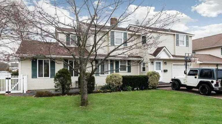 This Colonial is listed for $649,000 in July