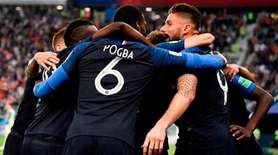 France's players celebrate the opening goal during the
