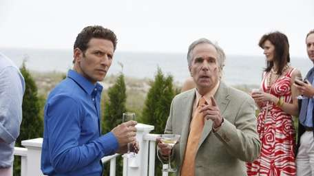 Mark Feuerstein, left, as Dr. Hank and Henry