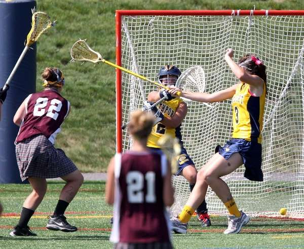 Bay Shore's Claire Healy (22) scores in the