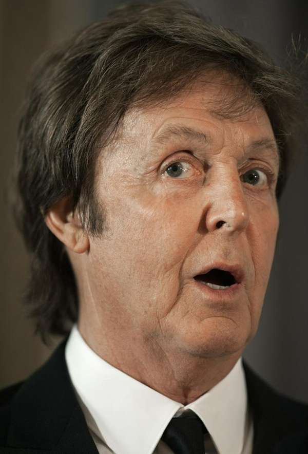 Paul McCartney addresses a news conference on June