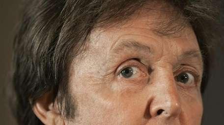 Paul McCartney addresses a news conference on June