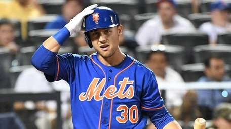 Mets leftfielder Michael Conforto reacts while batting against