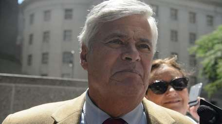 Dean Skelos, left, and his wife, Gail, right,