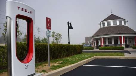 """A Tesla """"supercharging"""" station was placed outside Cafe"""