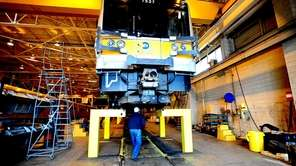 MTA workers work on LIRR equipment at the