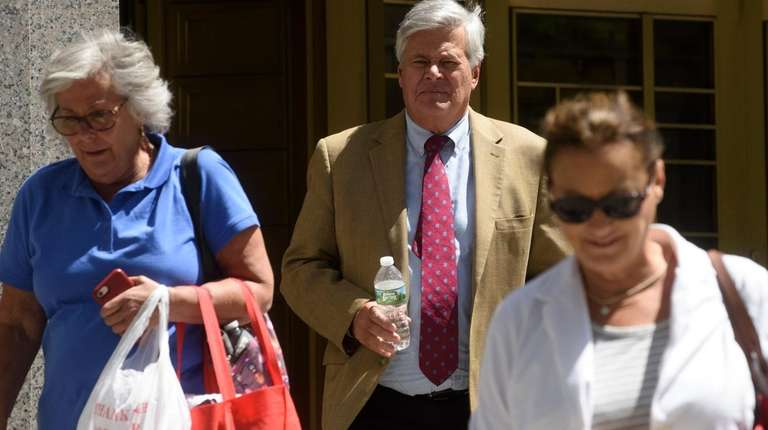 Dean Skelos, center, exits a federal courthouse in