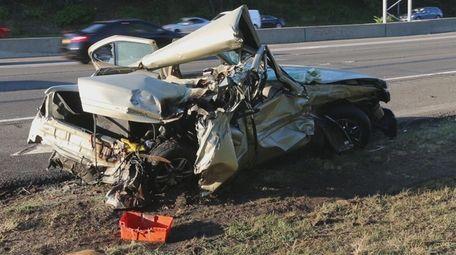 A crane slammed into a car on the