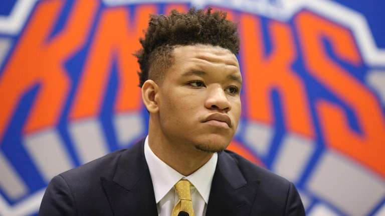 Knicks first-round draft pick Kevin Knox looks on
