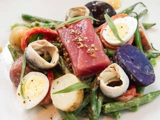Salade Nicoise is enriched with a generous cut