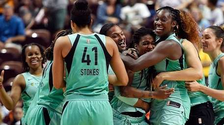 New York Liberty players mob guard Shavonte Zellous,