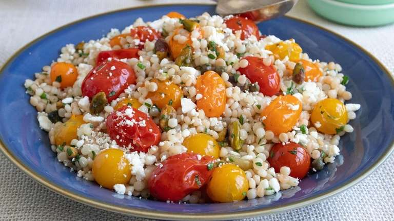 Pearl (Israeli) couscous, oven roasted cherry tomatoes, pistachios
