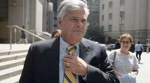 Dean Skelos leaves federal court in Manhattan during