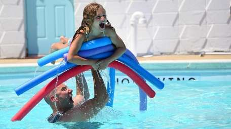 Samantha Rosenthal, 7, of Merrick, cools off at