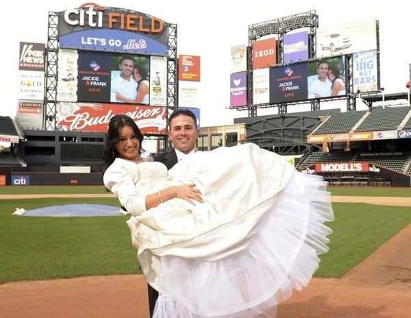 Newlyweds Jackie and Frank Caputo on home plate