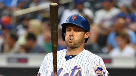 Mets center fielder Matthew den Dekker reacts while