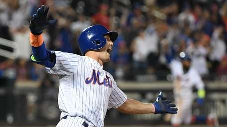 Mets pinch hitter Brandon Nimmo reacts as he