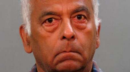 Ashok Vora, 70, of Manhasset was charged with