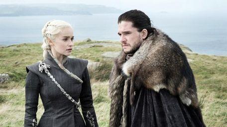 Emilia Clarke as Daenerys Targaryen and Kit Harington