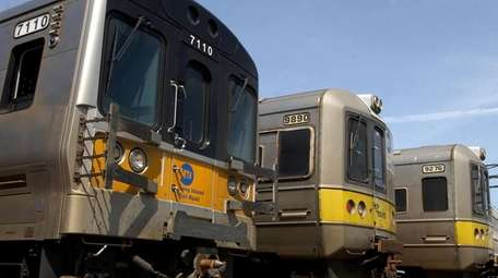 Three generations of LIRR trains sit at the