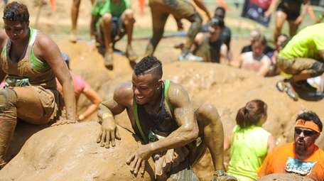Participants compete in the Mud Mile 2.0 obstacle