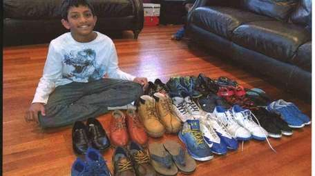 Kidsday reporter Noah Philip with his shoe collection.