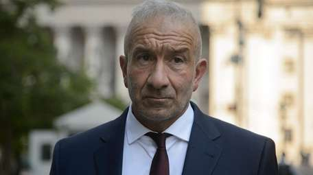 Former SUNY official Alain Kaloyeros leaves a federal