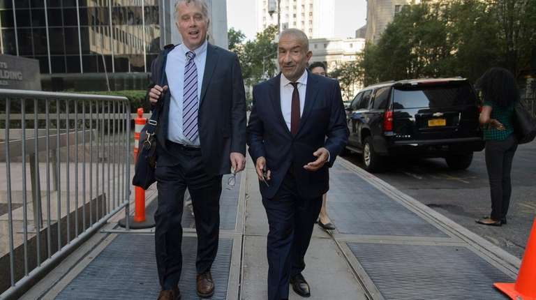 Former SUNY official Alain Kaloyeros, right, leaves a