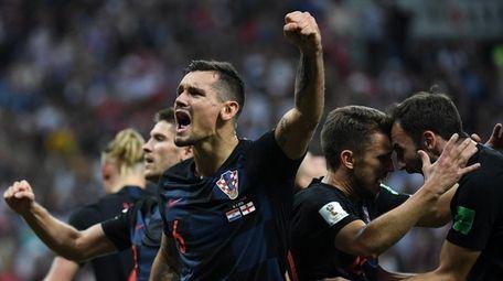 Croatia's defender Dejan Lovren (C) celebrates with teammates