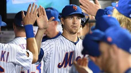The Mets' Jacob deGrom is greeted in the