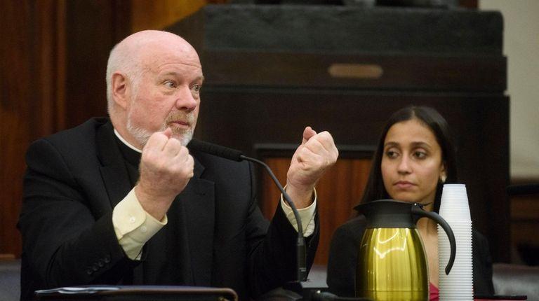 Monsignor Kevin Sullivan, left, executive director of Catholic