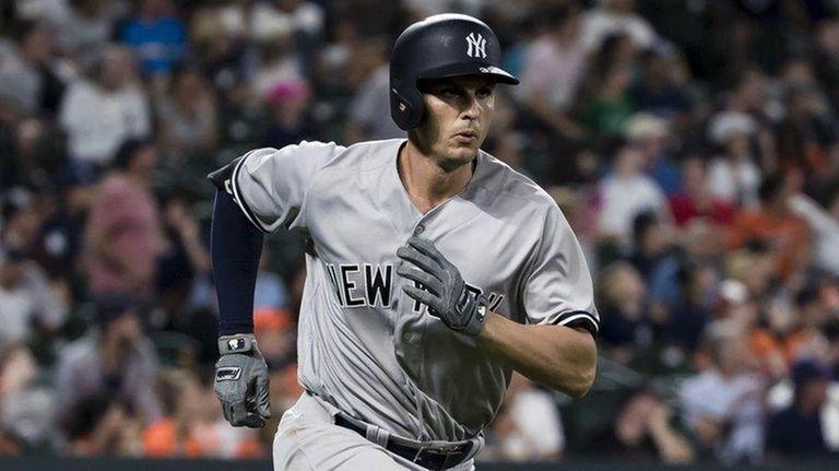 Greg Bird of the Yankees runs to first