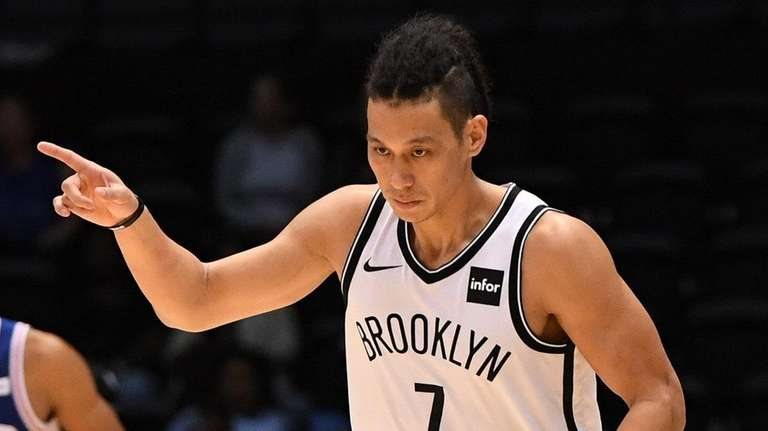 Nets guard Jeremy Lin reacts after sinking a