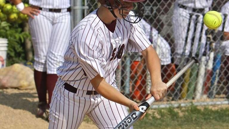 Bay Shore's Courtney Syrett tries to lay down