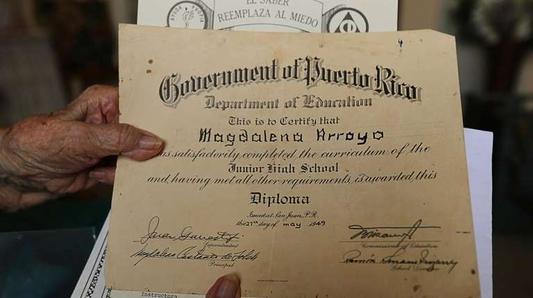 Magdalena Justiniano, who turns 104, shows off diplomas