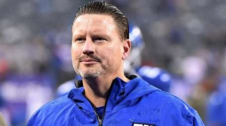 Ben McAdoo walks off the field after the