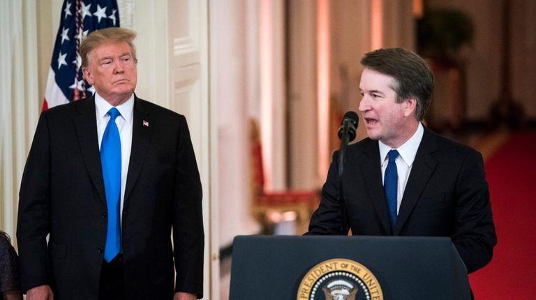 President Donald J. Trump listens to Judge Brett