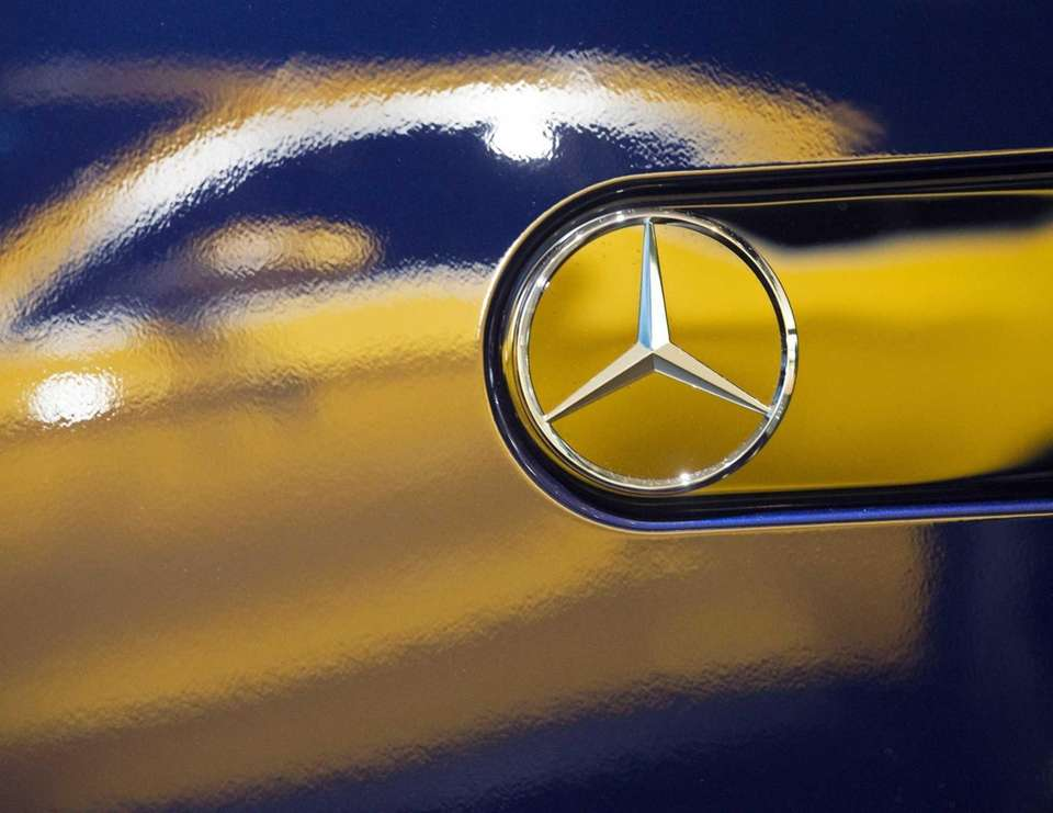 The Mercedes Concept GLC Coupe is reflected besides