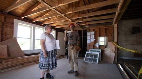 Babylon Town historian Mary Cascone and Chris Penders,