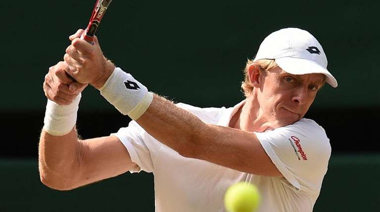 South Africa's Kevin Anderson returns against US player