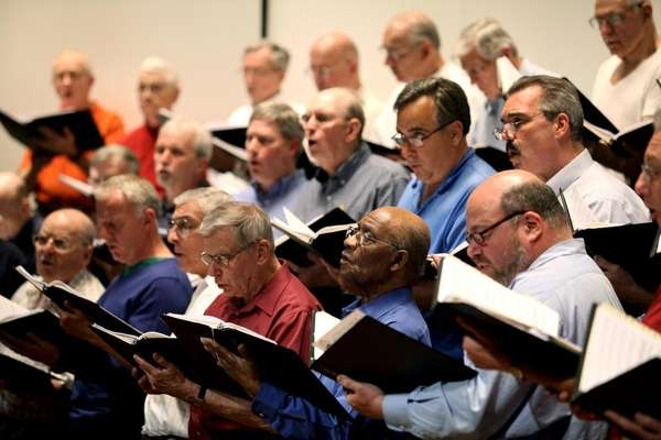 Members of the Huntington Men's Chorus rehearse at